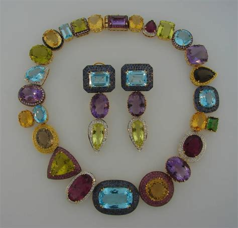 multi colored gemstones yellow gold necklace and earrings