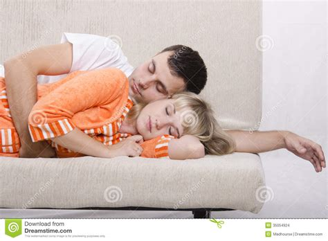 got a couple of couches sleep on the loveseat young couple sleeping on the couch stock images image