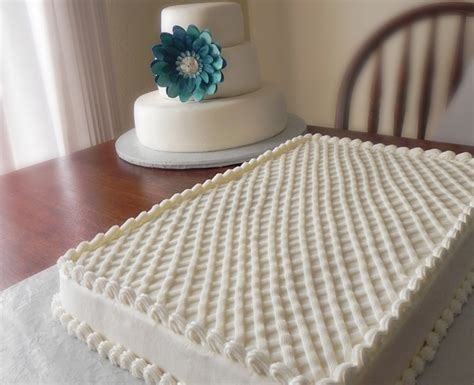 How To Decorate A Tiered Cake by The Three Tiered Wedding Cake And Two Sheet Cakes
