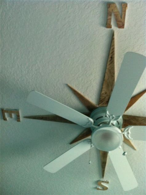 how to use nautical decor to create the perfect living room i made a nautical star on the ceiling around the fan using