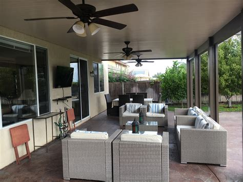 Patio Cover Lighting Ideas Alumawood Patio Cover Solid Top Three Ceiling Fans Electrical Outlets For Hanging Lights