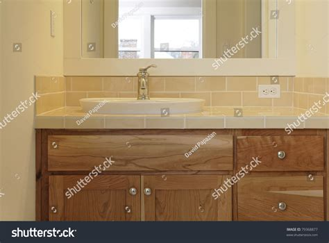 sink that sits on top of counter a tiled bathroom sink counter sits on top of wooden