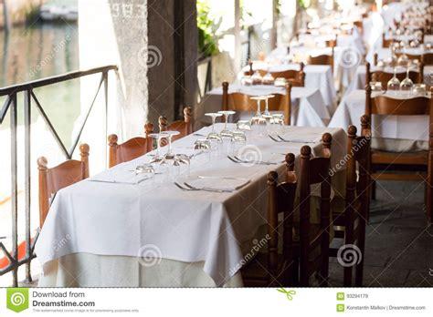 fancy place setting table in fancy restaurant set for dinner stock photo