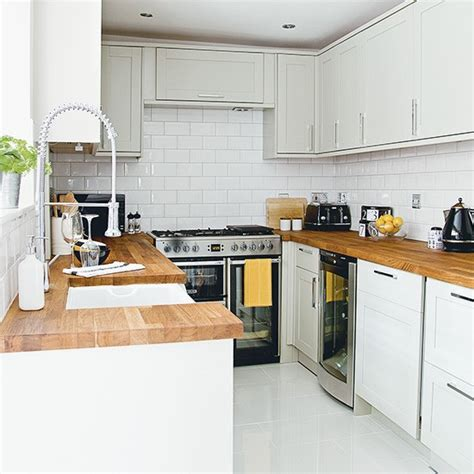 modern ikea kitchen with wooden worktops and a combination white kitchen with wooden worktops and metro tiles