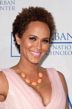 nicole mitchell short curly hairstyle for black women short natural hair twistout with side braids twa style