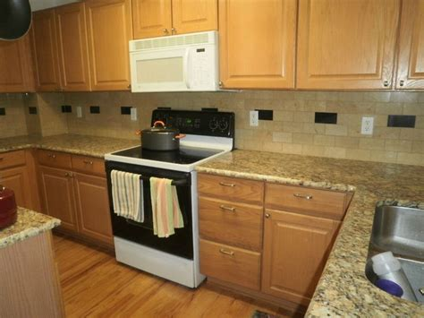 maple cabinets with granite countertops giallo ornamental granite with maple cabinets giallo