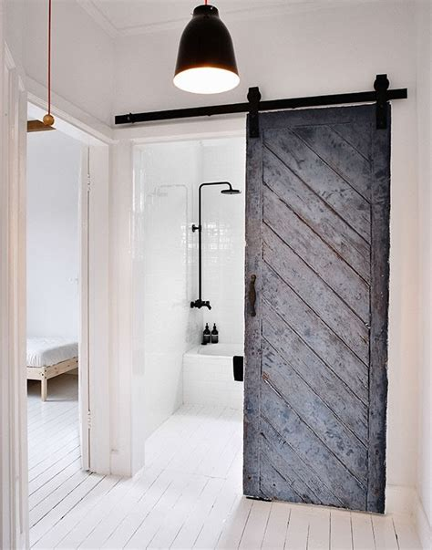 Bathroom Sliding Door Repair by 15 Sliding Barn Doors That Bring Rustic To The Bathroom