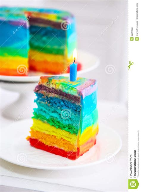 rainbow cake and cupcakes decorated with birthday candles rainbow cake decorated with birthday candle stock photo image 52382597