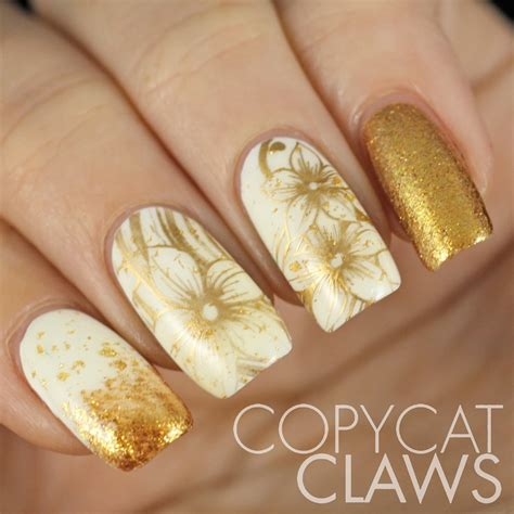 And Nails by Copycat Claws Sunday Sting White And Gold Nails