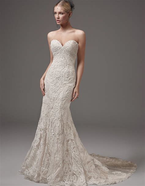 beading on the wedding dress to the right reminds me of indian 5 wedding dresses featuring bold lace by raffaele ciuca
