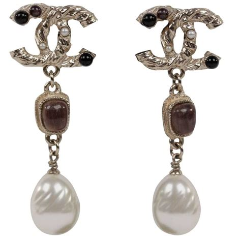 chanel gold metal cc top pierced earrings w brown stones