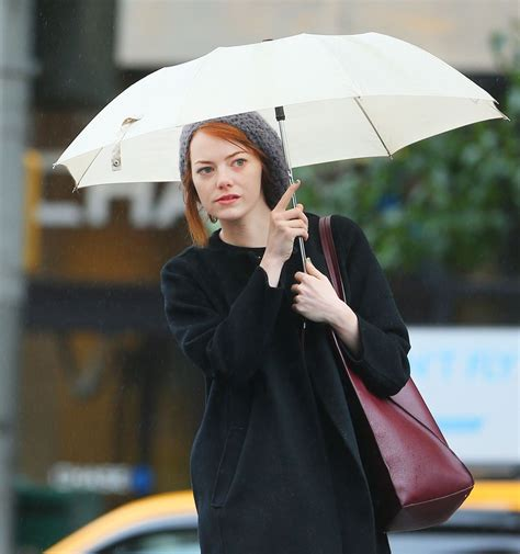 emma stone latest news emma stone in new york city out in the rain october 2014