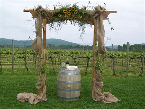 Decorated Wedding Arch with Burlap and Sunflowers. Perfect