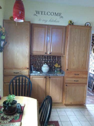 24x84x18 in pantry cabinet in unfinished oak hton bay 24x84x18 in pantry cabinet in unfisnished oak