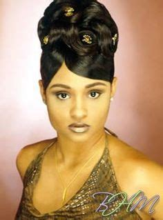 african american hairstlye from the 90s african american french twist updo with side swept bangs