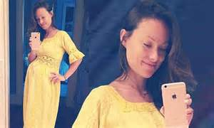 inside olivia wilde s brooklyn home pursuitist olivia wilde glows in a bright yellow vintage dress