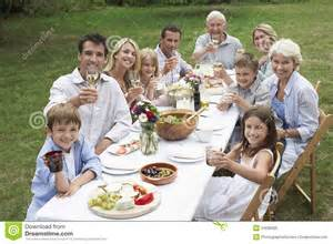 The Backyard Restaurant Happy Family Dining Together In Garden Royalty Free Stock