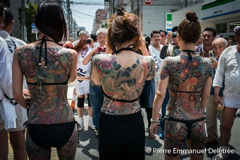 yakuza tattoo festival yakuza wives show their traditional tattoo during the