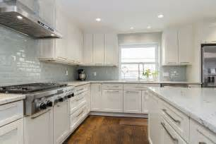 Backsplash For Kitchen With White Cabinet by River White Granite White Cabinets Backsplash Ideas