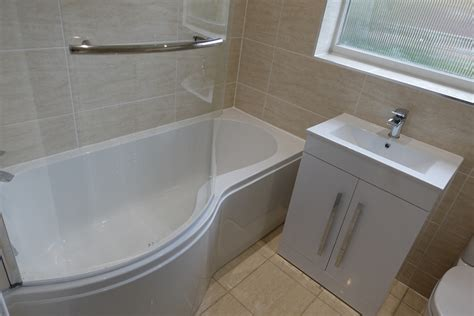 curved bathtub kenilworth home refitted with p shaped bath and trion shower
