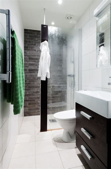 how to make a small bathroom look like a spa like the idea of the glass door coming out half way good
