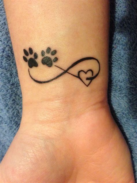 paw print tattoos on wrist paw prints and infinity symbol on wrist