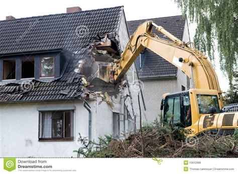 demolishing a house digger demolishing house royalty free stock image image 10612986