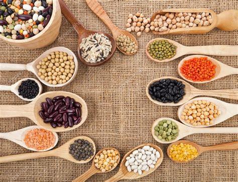 food ingredients various food ingredients beans legumes peas lentils in wooden spoon on the