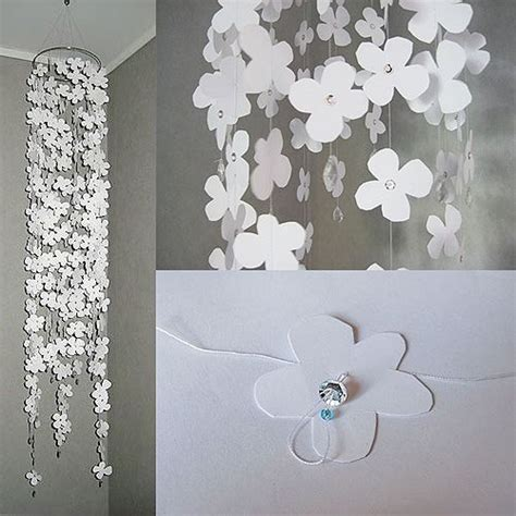 Hanging Paper Crafts - hanging flower mobile with paper cutouts and