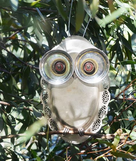 ornaments made from recycled materials artisans upcycle trash repurposing into wares for garden