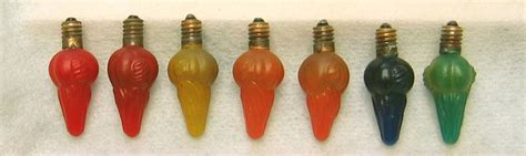 antique christmas ornaments  vintage christmas light bulbs houses buildings