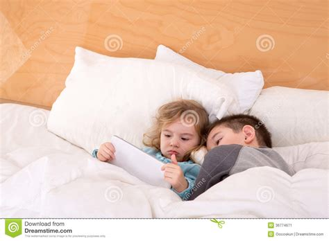 brother sister share bed tired little brother and sister in a warm bed stock image image 36774671