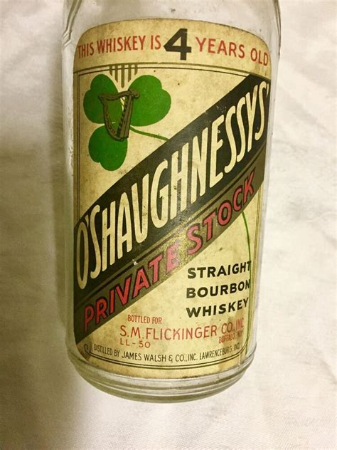 whiskey colored antique whiskey colored paper label reads oshaughnessys
