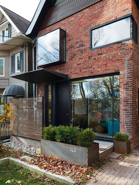 brick house renovation ideas early 1900s toronto home with a glassy modern renovation