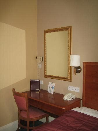 desk next to the bed picture of hotel edinburgh