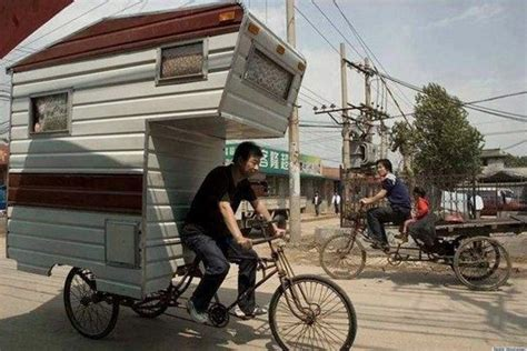 tiny trailer pulled by bicycle rider may really be the