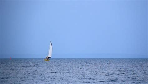 distances by boat sail boat in the distance sailing the sea stock footage