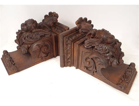 pair of wood carved and pair consoles of wooden carved wood heads antifreezes