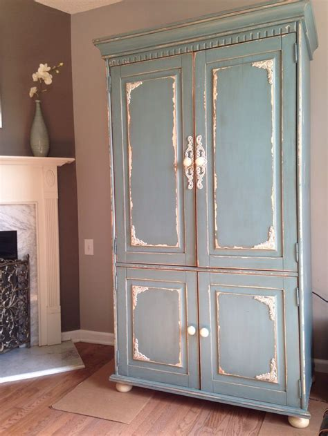 distressed armoire moody blue distressed armoire project gallery rustic