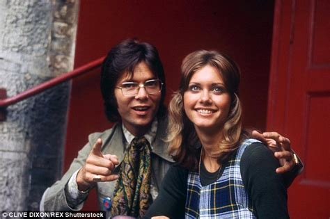 olivia newton john and cliff richard olivia newton john gives cliff richard a birthday hug at