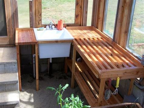 potting bench for greenhouse love this idea built right around a utility sink