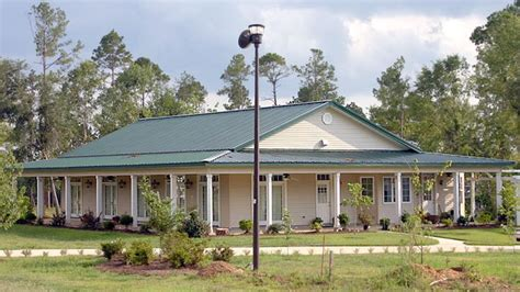 metal house plans with wrap around porch nice wraparound porch on this barndo kodiak steel homes