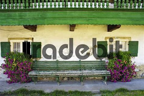 alp front bench garden bench in front of farm house foothills of the alps