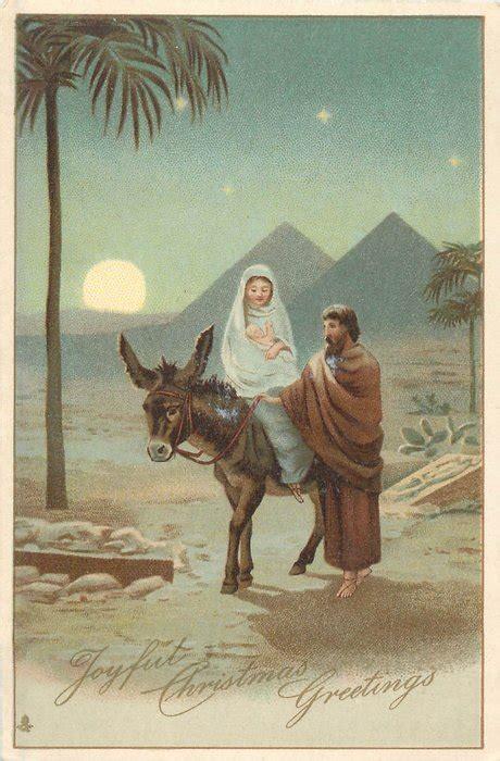 joyful christmas  jesus mary ride donkey  desert  front  pyramids evening