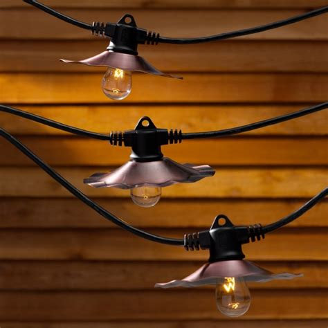 string lights with copper shades and 7 light bulbs 35ft 357cop destination lighting