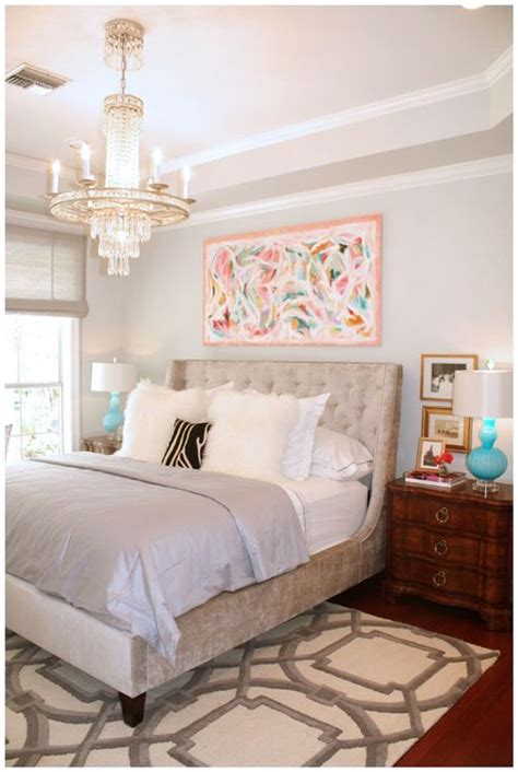 bed placement in master bedroom neutral bedroom with splashes of color and proper rug