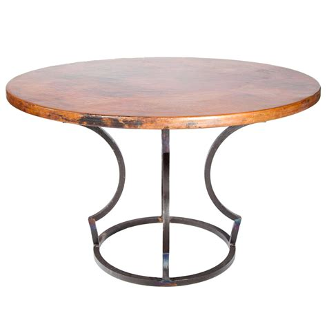 charles iron dining table with 54 quot hammered copper top