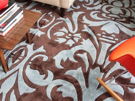 how to out an area rug how to make one large custom area rug from several small ones hgtv