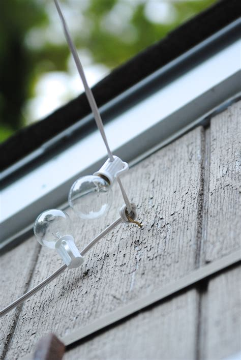 diy patio lights how to hang outdoor string lights the deck diaries part