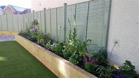 artificial grass raised beds patio with seating